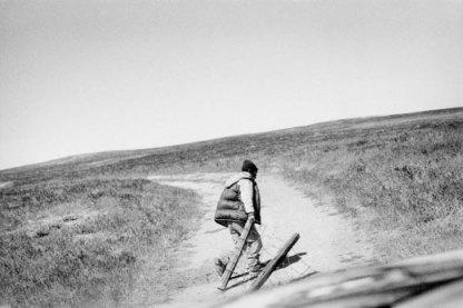 A shepherd opens his pasture's gate. Coalinga, California.