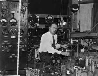 Professor Ernest Orlando Lawrence sitting at the control table of the 27-inch cyclotron. Photo taken in 1933 or 1934.
