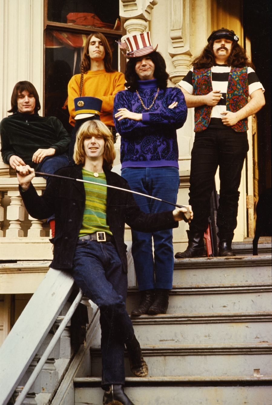 [The Grateful Dead on steps of 710 Ashbury Street headquarters,