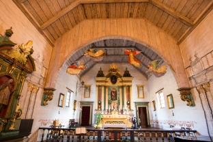 Mission San José's church features angel cut-outs and other whimsical elements.