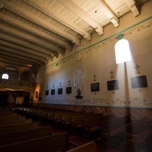 Light streams through a window in Mission Santa Inés.